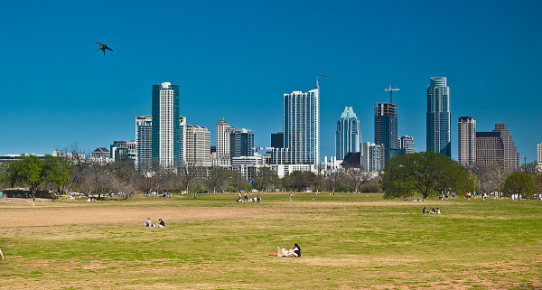 austin-downtown  > Skyline of Austin Downtown as viewed from the kite field in Zilker park.