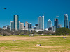 austin-downtown &gt; Skyline of Austin Downtown as viewed from the kite field in Zilker park.