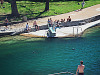 austin-downtown &gt; A man jumps into the pool of Barton Springs in Austin, Texas