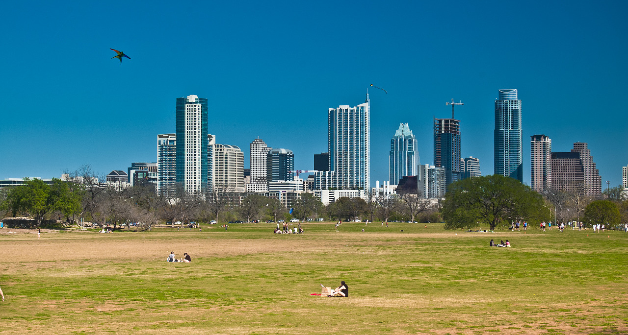 Skyline of Austin Downtown as viewed from the kite field in Zilker park.