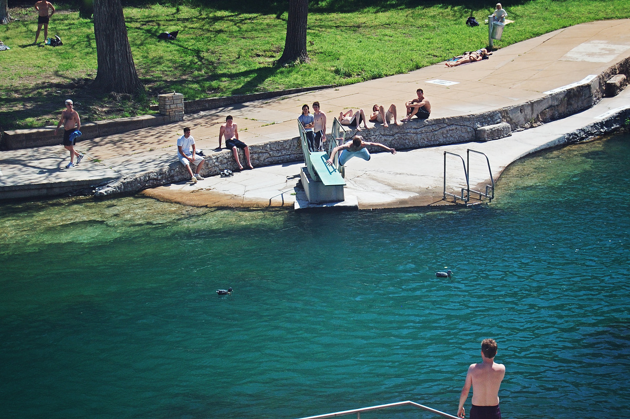 A man jumps into the pool of Barton Springs in Austin, Texas