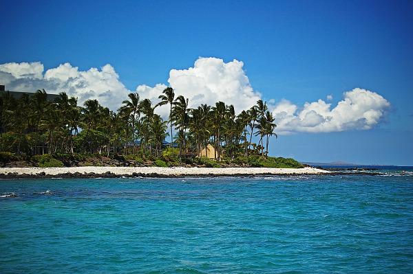 beach white clouds blue water hilton waikoloa