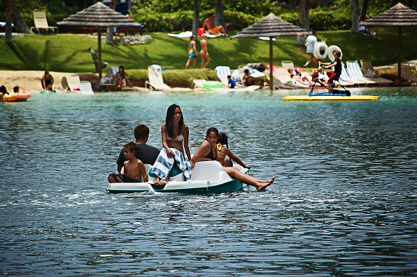 big-island-hawaii  > Boys and girls floating on a pedalo in the Waikoloa Village lagoon