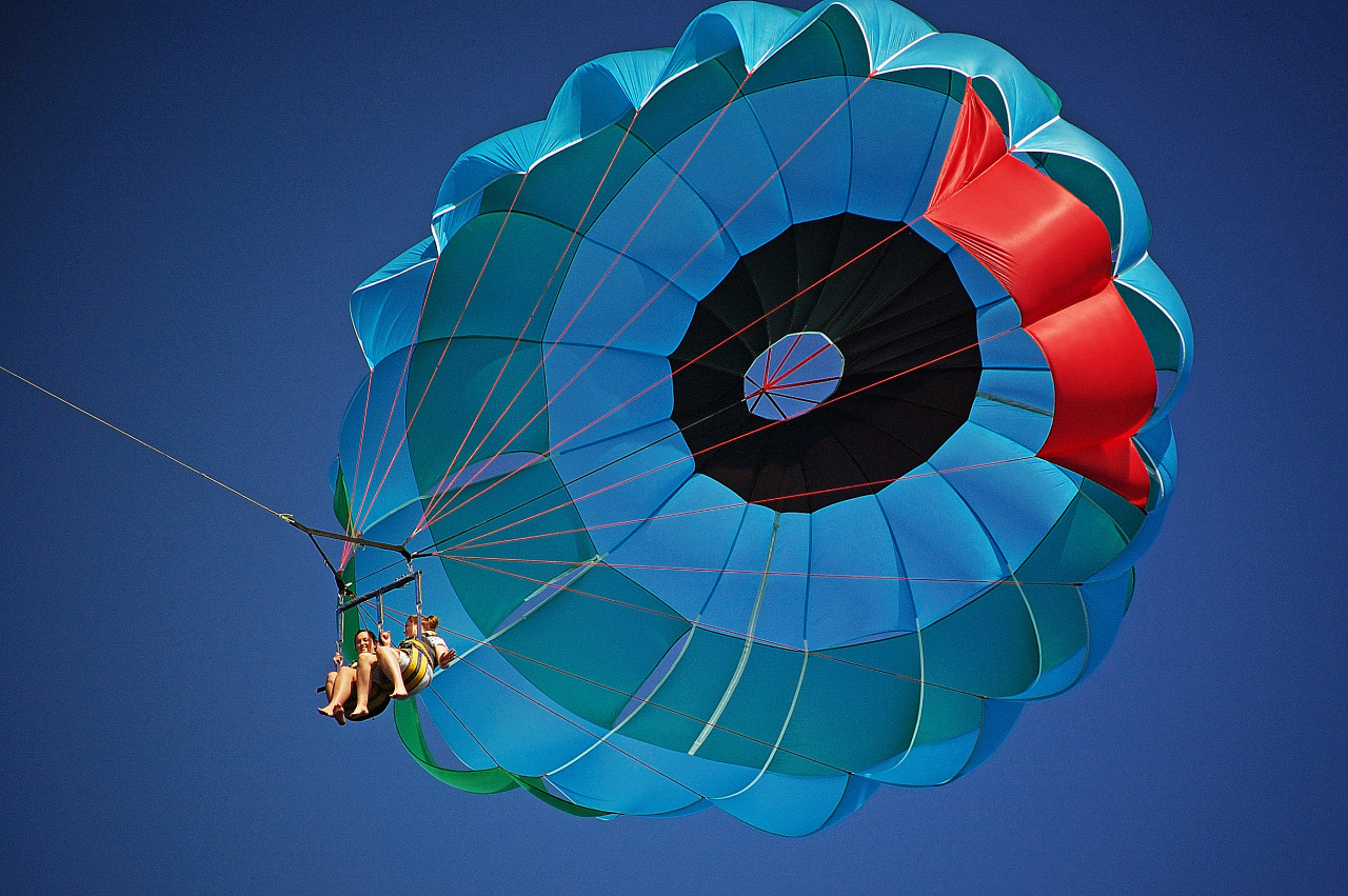 Parasail floating in the blue sky of the Big Island