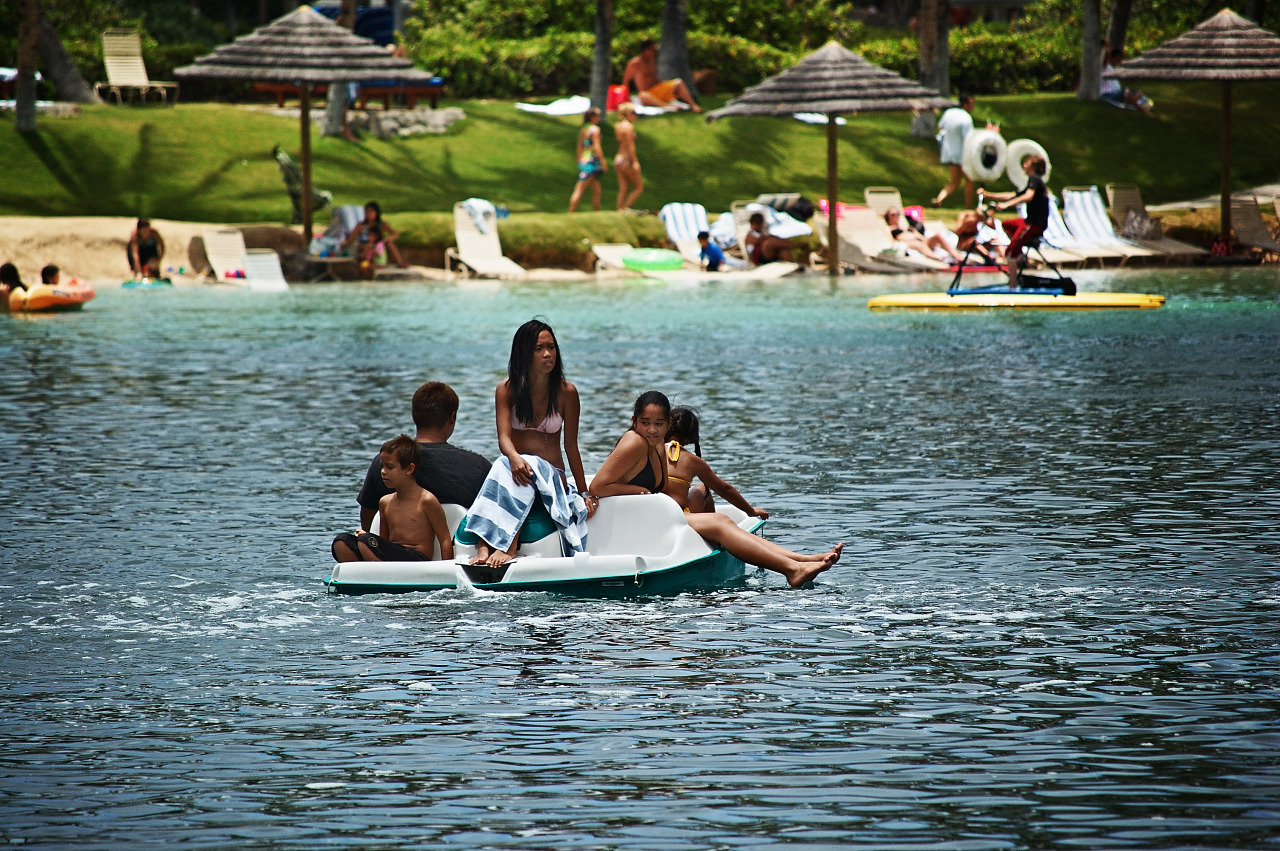Boys and girls floating on a pedalo in the Waikoloa Village lagoon