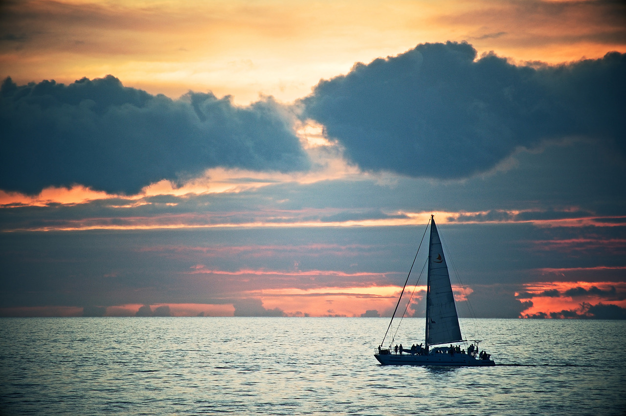 Boat sailing on sunset in Waikoloa Beach