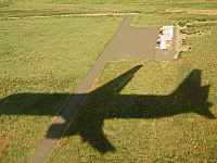 big-island-hawaii > plane landing shadow grass denver airport