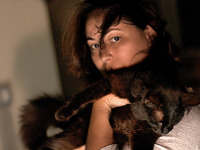 black-cute-cat > Cat held in arms