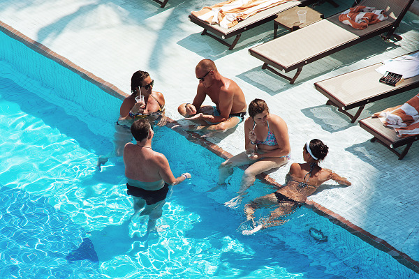 Tourist group drinking in the Swimming pool of the Hyatt Zilara Hotel in Cancún