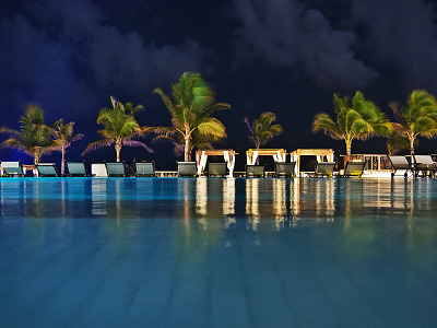 cancun-mexico-2014 > Reflection on the pool at night at the Hyatt Zilara hotel in Cancún