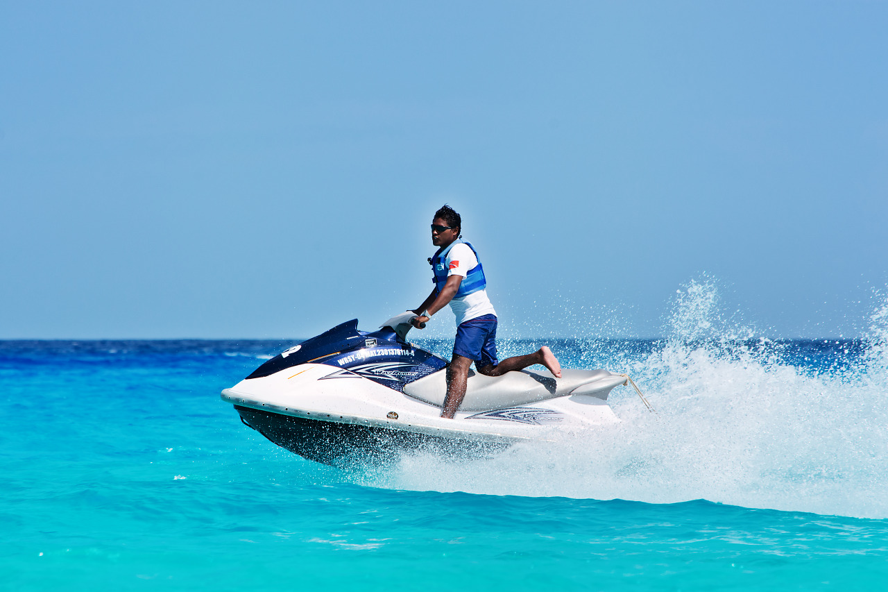 Jet ski riding on the blue water of the beach in Cancún