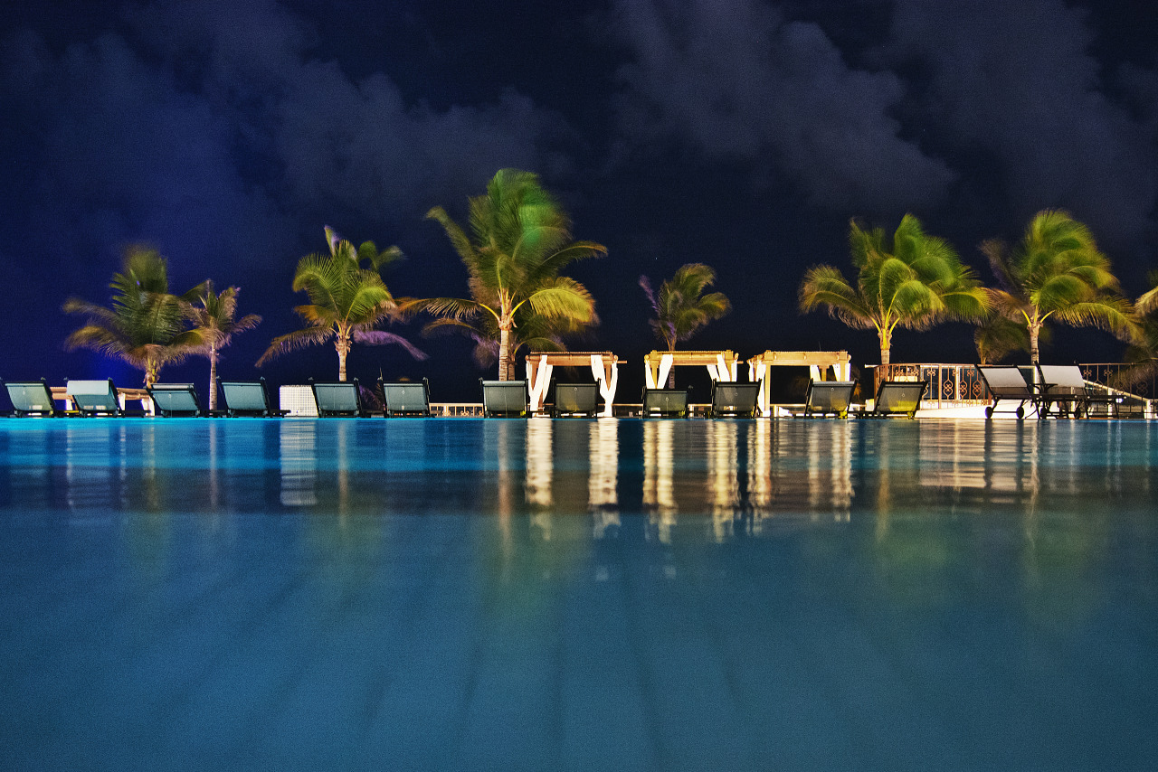 Reflection on the pool at night at the Hyatt Zilara hotel in Cancún
