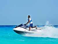 cancun-mexico-2014 > Jet ski riding on the blue water of the beach in Cancún