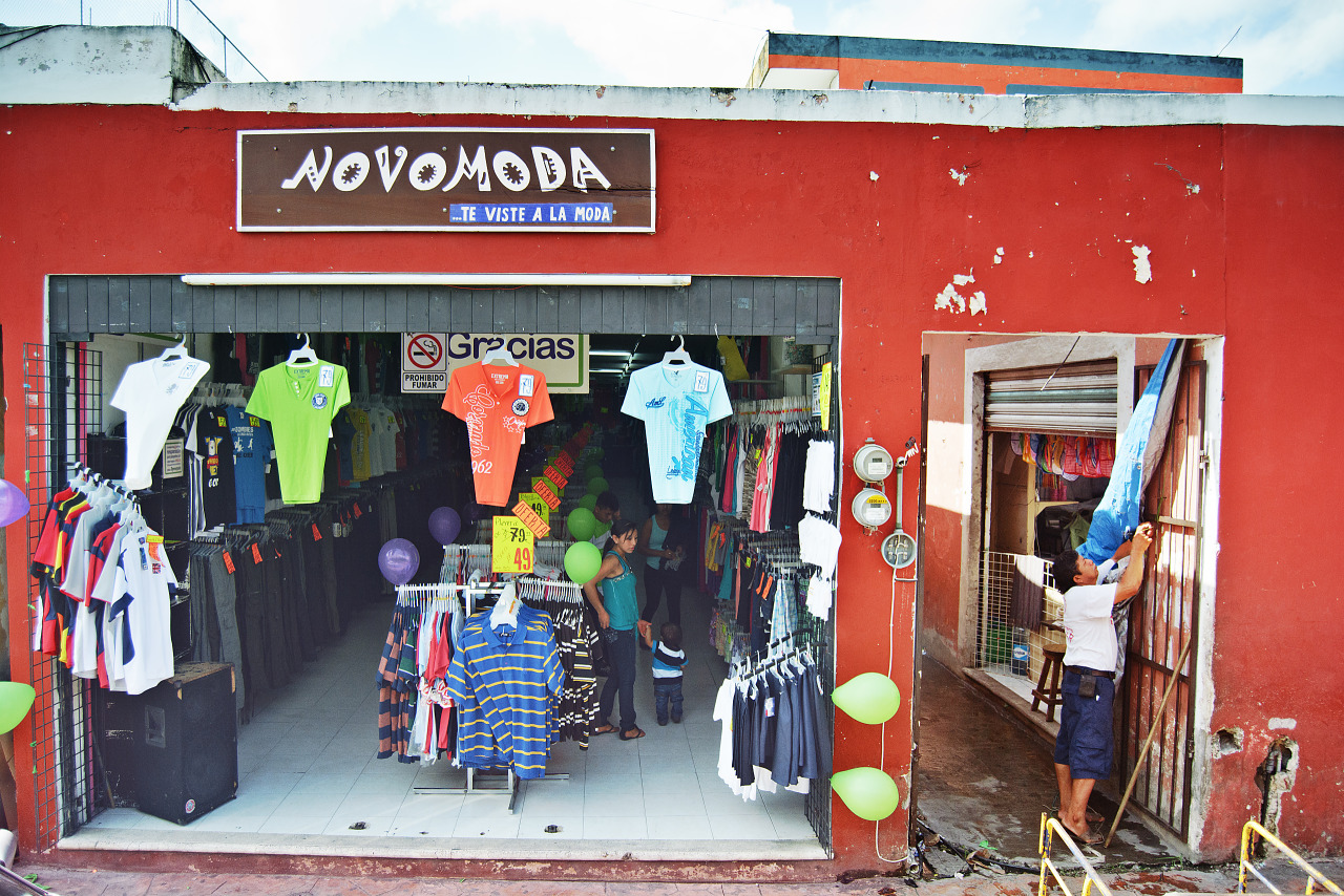 Clothes shop with red wall a street scene in Valladolid Mexico