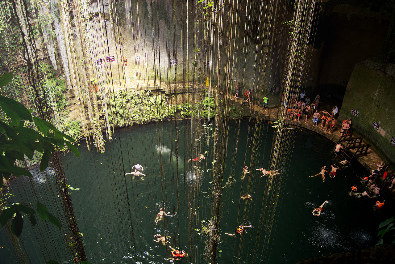 Swimmers viewed from above in the Cenote Ik Kil in Yucatan