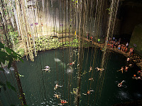 chichen-itza-valladolid-yucatan > Swimmers viewed from above in the Cenote Ik Kil in Yucatan
