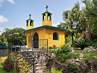 chichen-itza-valladolid-yucatan > Yellow and green miniature church a street scene in Yucatan Mexico