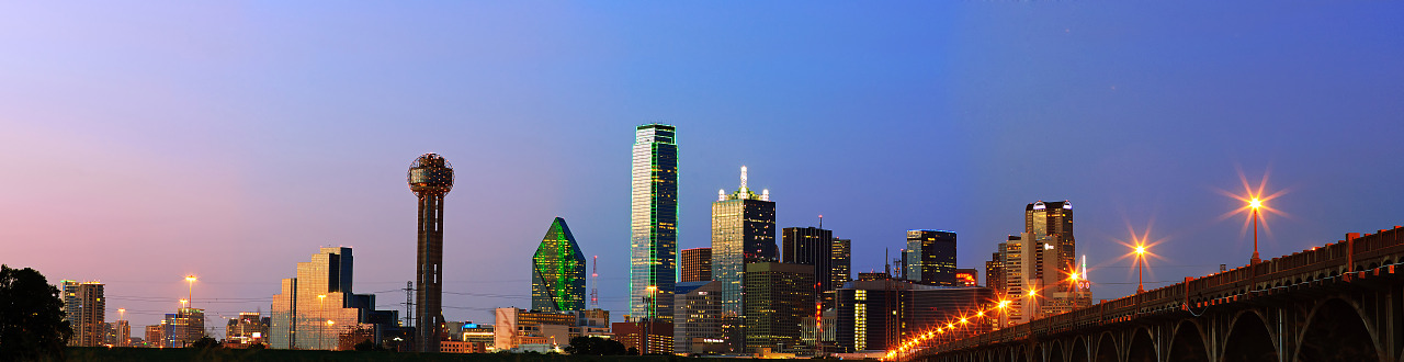 Large view of the downtown Dallas skyline by night.