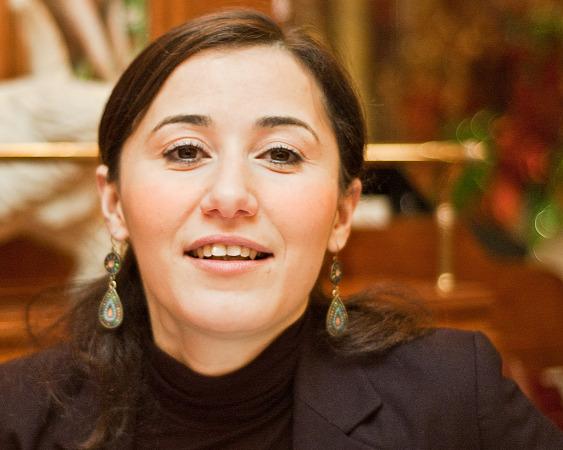 Radia smiling in restaurant au chien qui fume, Paris, France