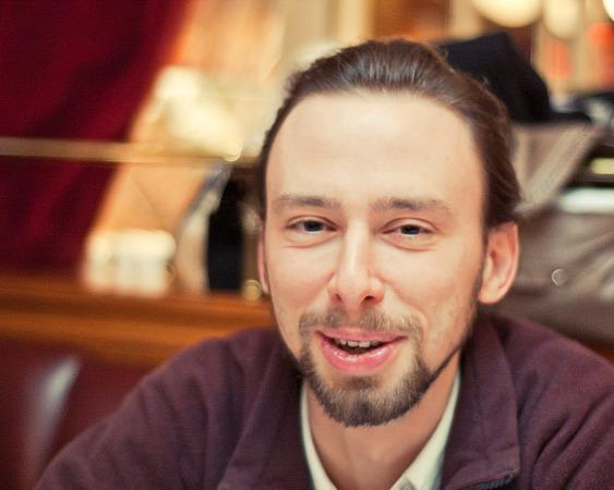 Xavier talking in restaurant Au chien qui fume, Paris, France