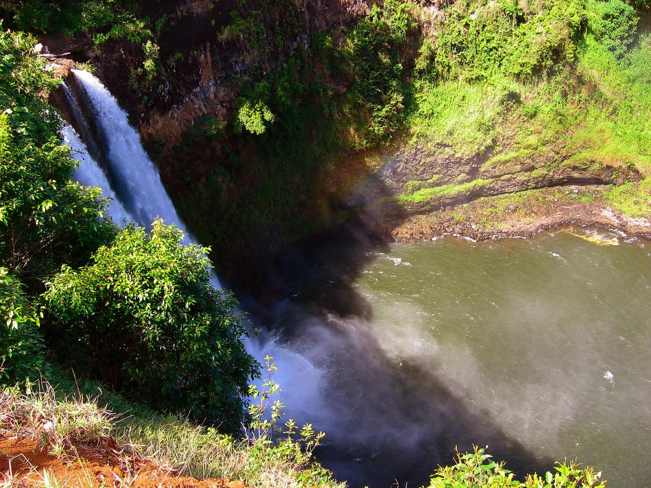 Rainbow at the Wailua falls in Kauai, Hawaii