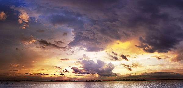 Panorama shot of sunset with spectacular clouds at Lake Pflugerville