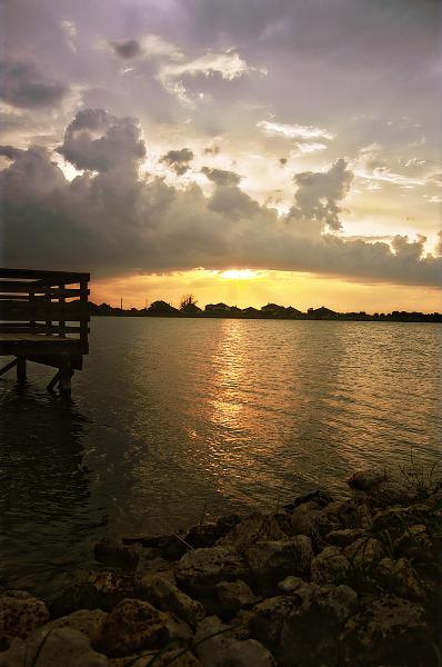 Rocky beach near the pier at sunset