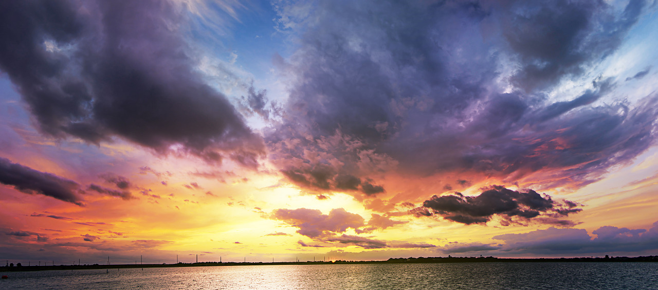 Spectacular colors at sunset with clouds at Lake Pflugerville