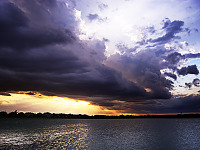 lake-pflugerville-sunset > Rolling cloud storm at sunset at Lake Pflugerville