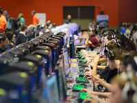 paxsouth-2016 > Keyboards and monitors lit up in the PC Gaming area of PAX South