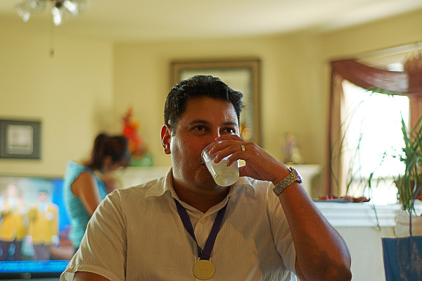 Tony drinking at baby shower
