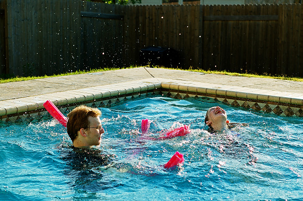 Gabriel and Leandra having fun in swimming pool