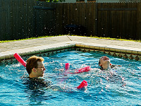 pflugerville-texas > Gabriel and Leandra having fun in swimming pool