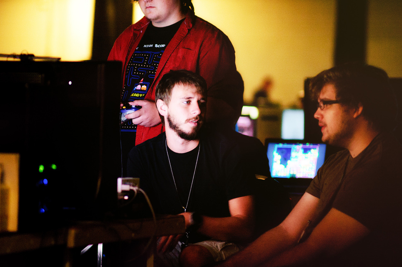 Quakecon 2011 - players at lan party in monitor light