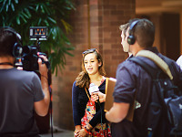 quakecon-dallas-2011 > Quakecon 2011 - reporters interviewing a girl player