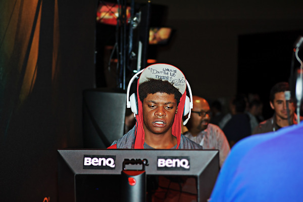 Player wearing quote cap on the showfloor in Quakecon 2012
