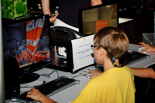 Children playing at Minecraft booth, at Quakecon 2012