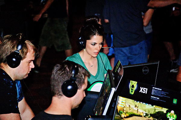 Gamer girl competing on the Dell Booth at Quakecon 2012