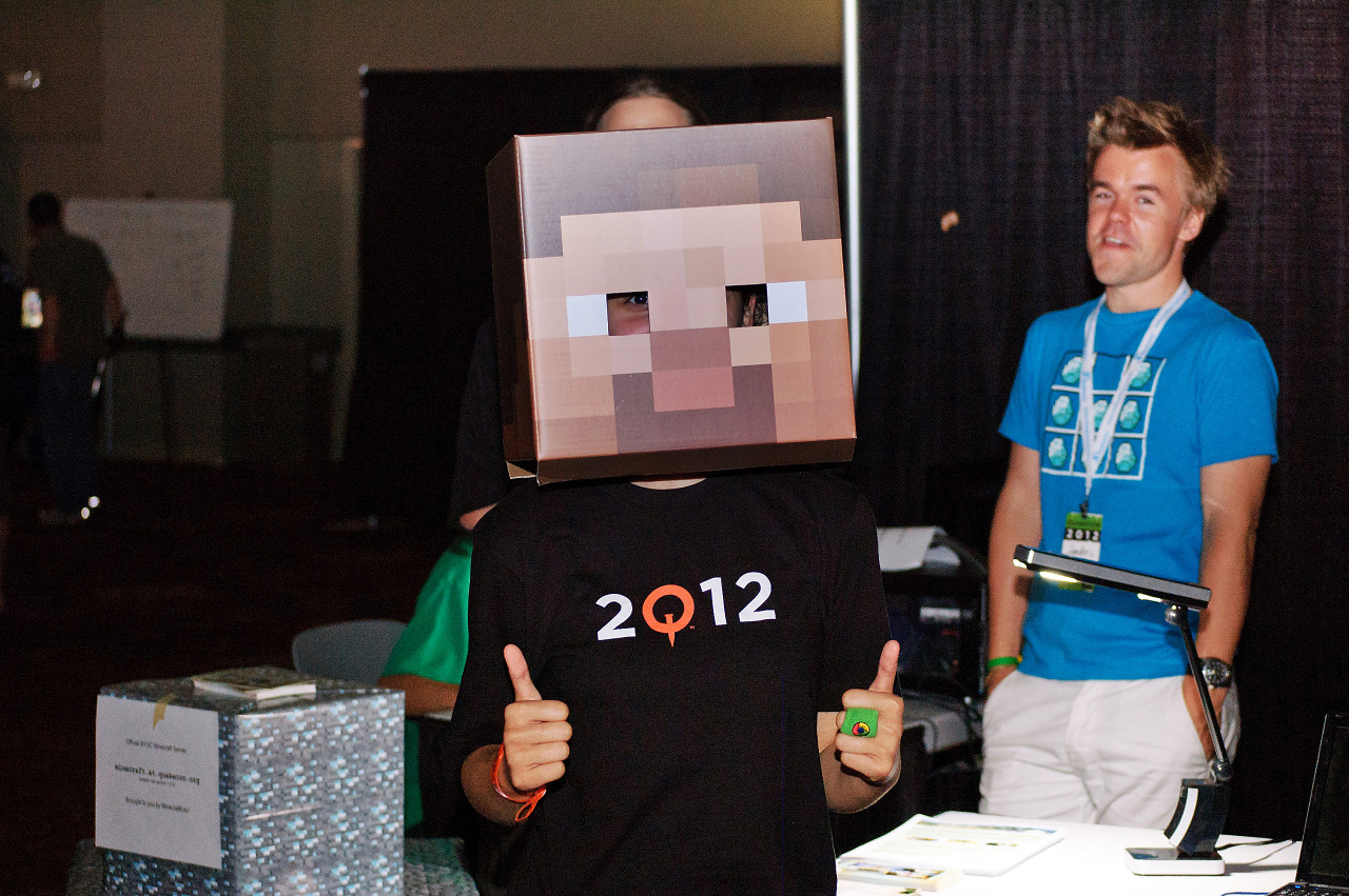 A fan girl wearing a Minecraft head mask at Quakecon 2012