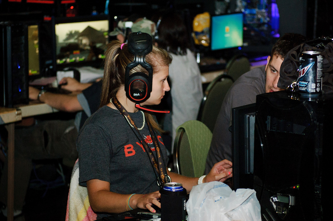 Large headset player girl in the BYOC area of Quakecon 2012