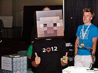 quakecon-dallas-2012 > A fan girl wearing a Minecraft head mask at Quakecon 2012