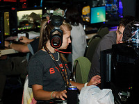 quakecon-dallas-2012 > Large headset player girl in the BYOC area of Quakecon 2012