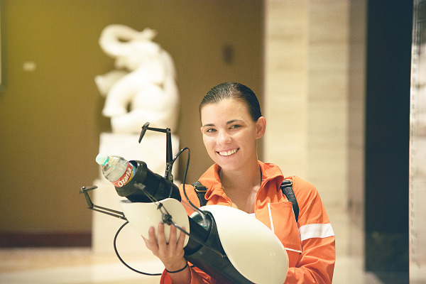 Girl doing a cosplay of Chell from Portal at Quakecon 2013