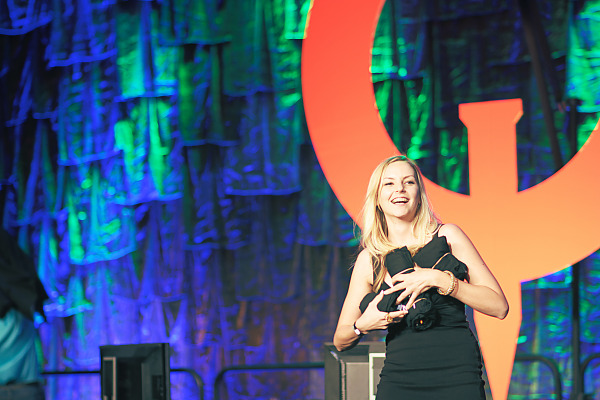 Quakecon girl throwing t-shirts on main stage of Quakecon 2013