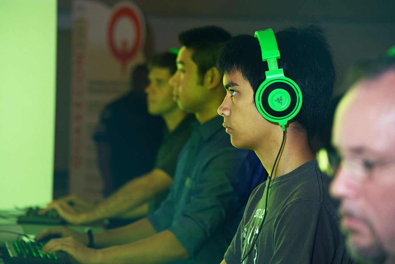 Green headphones gamer at Nvidia booth Quakecon 2013