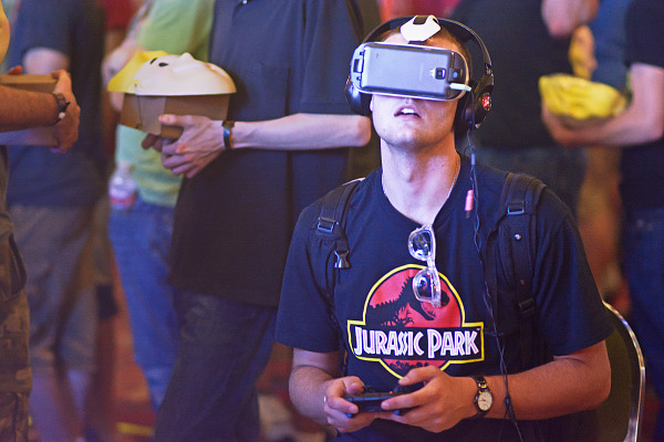 Quakecon attendee with Jurassic Park shirt and Gear VR demo
