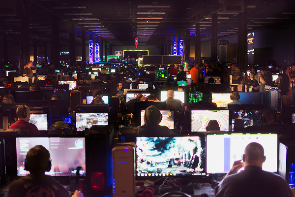 Room full of PCs lit with monitors at the BYOC LAN Party of Quakecon