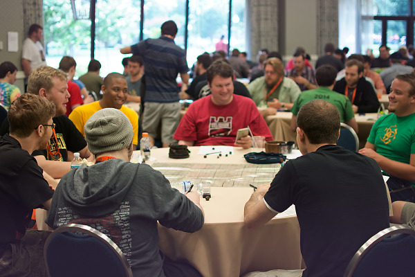 Room of gamers playing RPGs and board games Quakecon