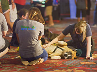 quakecon-dallas-2015 > Dallas Pets Alive charity with friendly dog on Quakecon showfloor