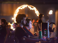quakecon-dallas-2015 > Gamers playing in front of light arch - Quakecon BYOC